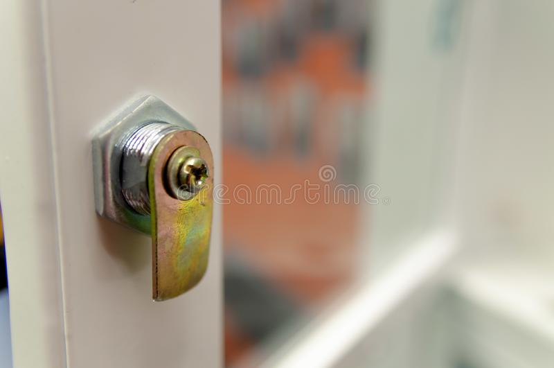 Glass luggage storage door with a very simple lock stock photo