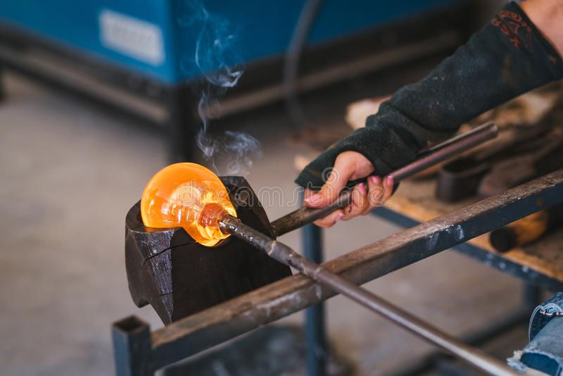 Glass making process. The process of making glass culptures royalty free stock photography