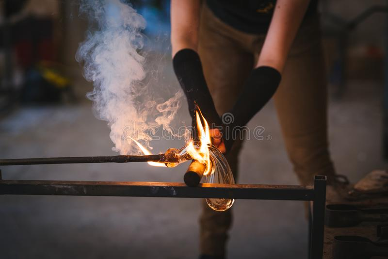 Glass making process. The process of making glass culptures stock image