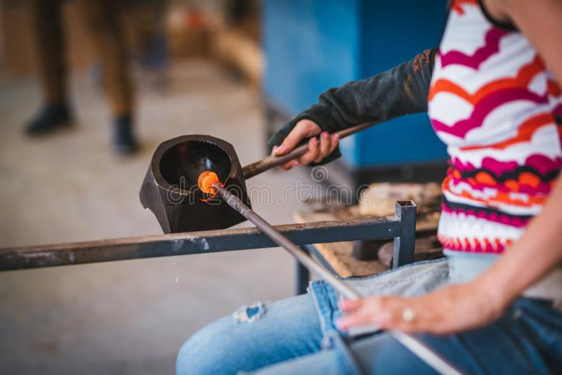 Glass making process. The process of making glass culptures royalty free stock photo