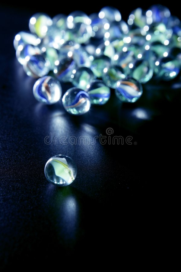 Glass marbles with blue reflections stock photos