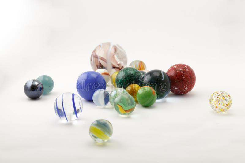 Glass marbles in a lightbox stock photo