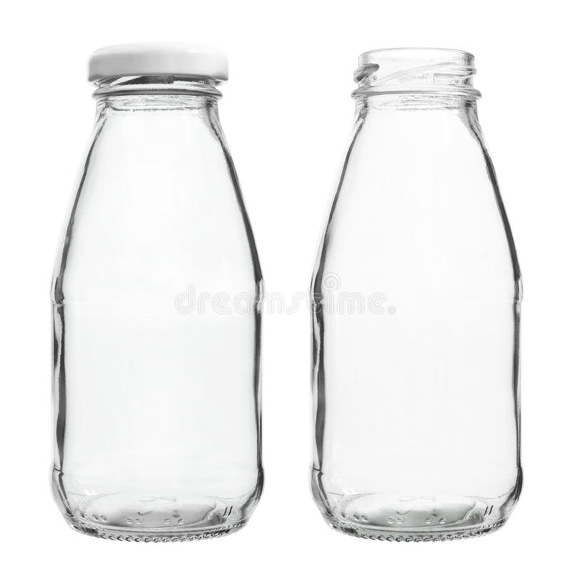Glass Milk Bottles with/without Cap isolated on white background. Two Glass Milk Bottles with and without Cap isolated on white background royalty free stock photos