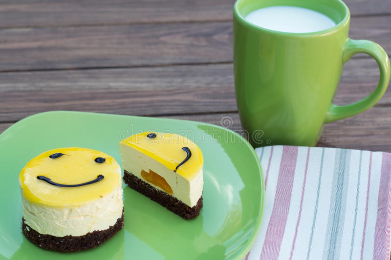 Glass of milk and two cakes on a plate & Glass of milk and cake stock photo. Image of yellow milk - 45926262