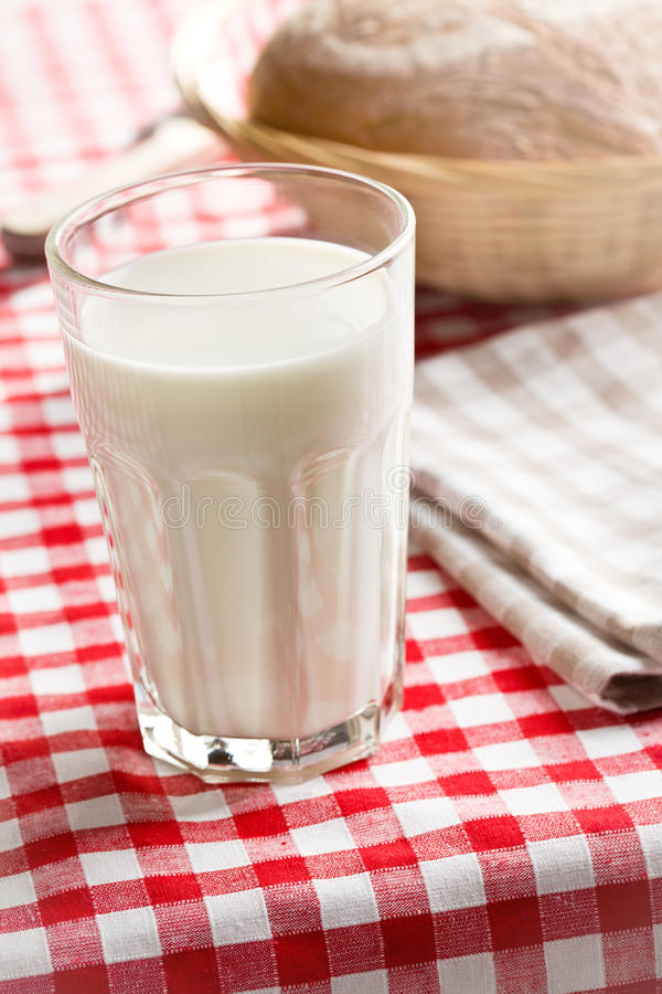 Download Glass Of Milk On Checkered Tablecloth Stock Photo - Image: 29177610