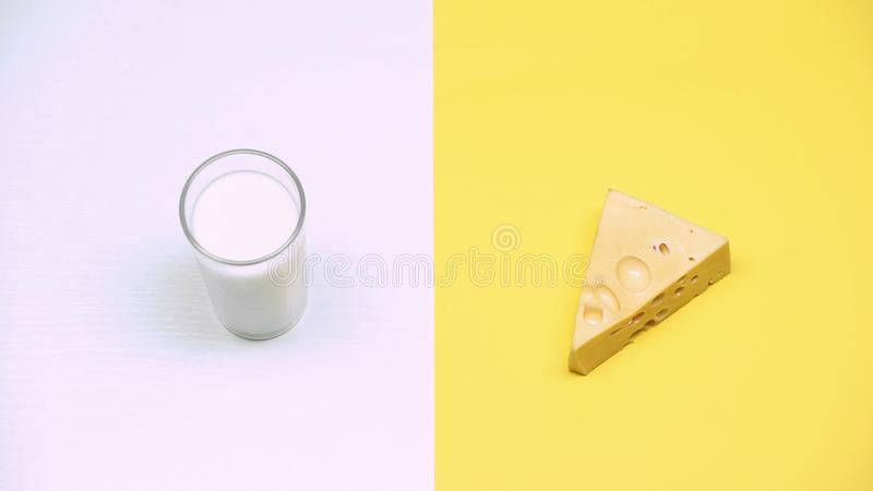 Glass of milk and cheese, dairy products rich in calcium, lactose intolerance royalty free stock photography