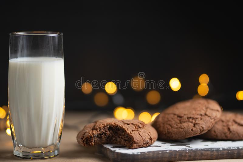 A glass of milk and chocolate cookies, with beautiful lights and Concept, copy Space royalty free stock photos