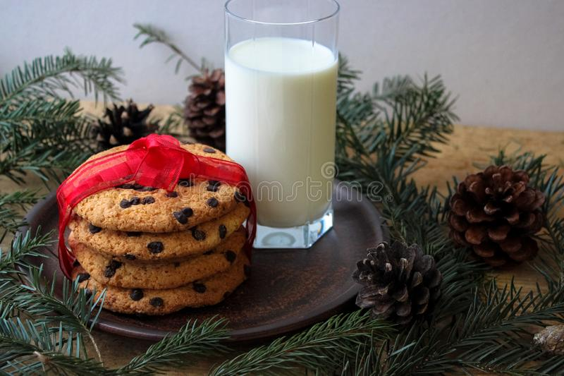A glass of milk and cookies for Santa. stock photography
