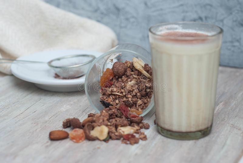 Glass of Milk with Granola Cereals with Dried Fruits overRustic Wodden Board. Healthy Food Breakfast. royalty free stock photos