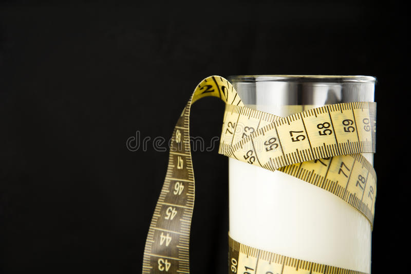 Glass of milk with meter, diet concept stock photos