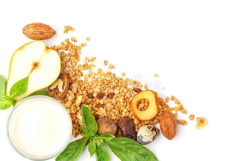 A glass of milk and muesli with fruits and herbs on a white background. Isolated. Full fresh ingredient food healthy breakfast corn liquid product oat flakes royalty free stock photos