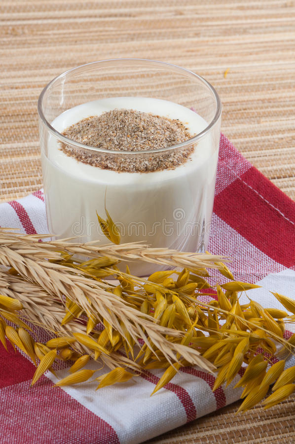 Glass of milk and wheat ears royalty free stock photos
