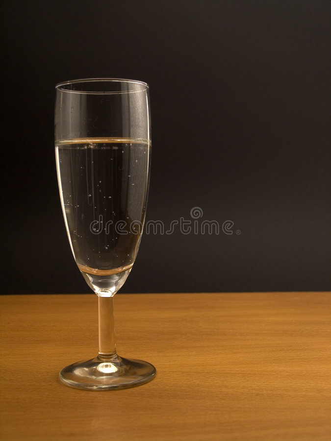 Glass of mineral water on tabletop royalty free stock photo