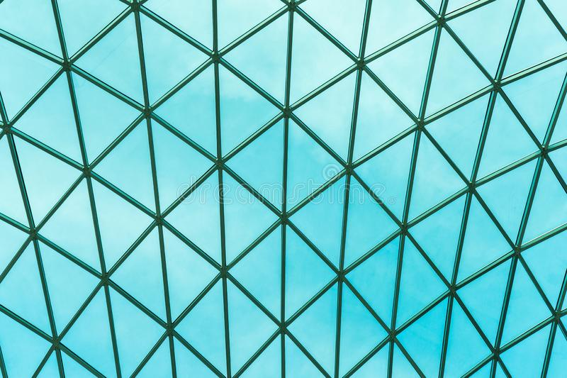 Glass modern panoramic roof.Structural glass facade curving roof.  royalty free stock images