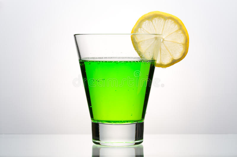 Glass of mojito. Mojito glass on a gray background royalty free stock images