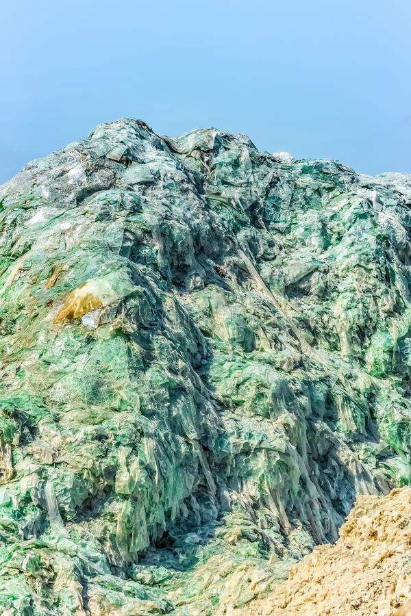 Glass mountain from windshields of cars in a trash royalty free stock photos