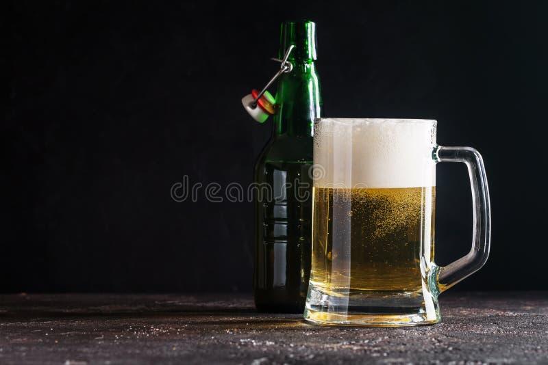 Glass mug of light beer stock photos