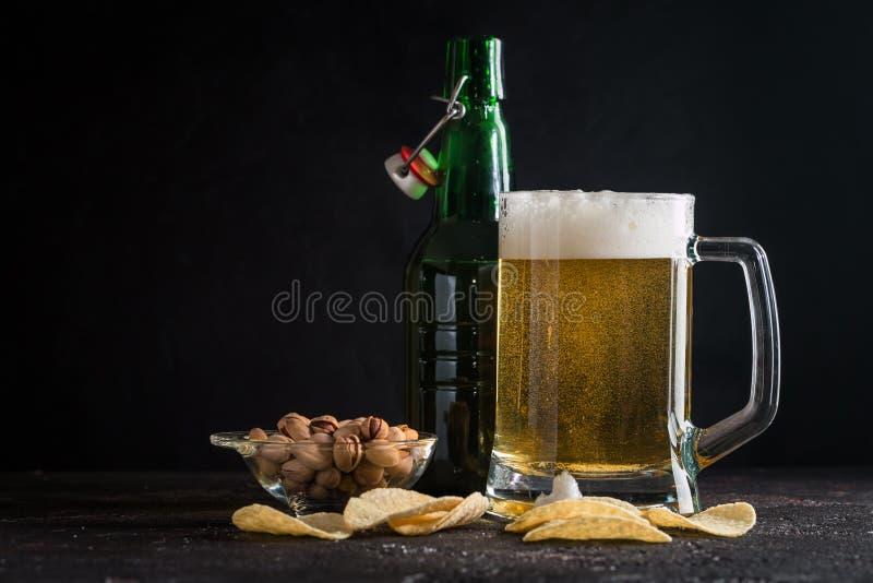 Glass mug of light beer royalty free stock images
