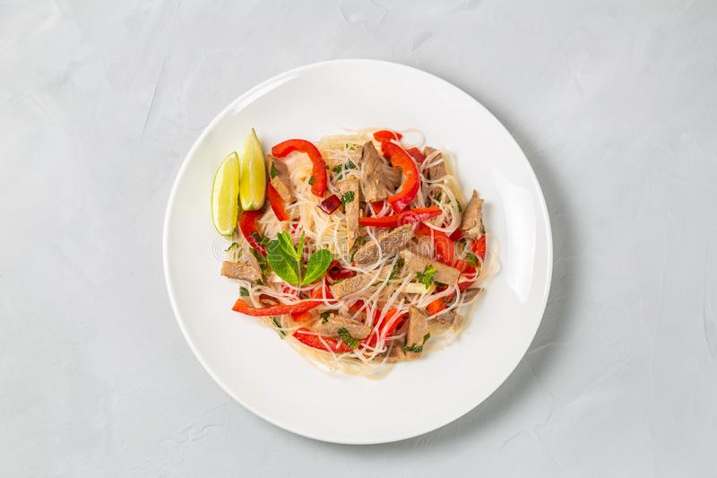 Glass noodles salad with meat. The view from the top. Copy-space. Slat of glass noodles and meat cooked on the street royalty free stock photo
