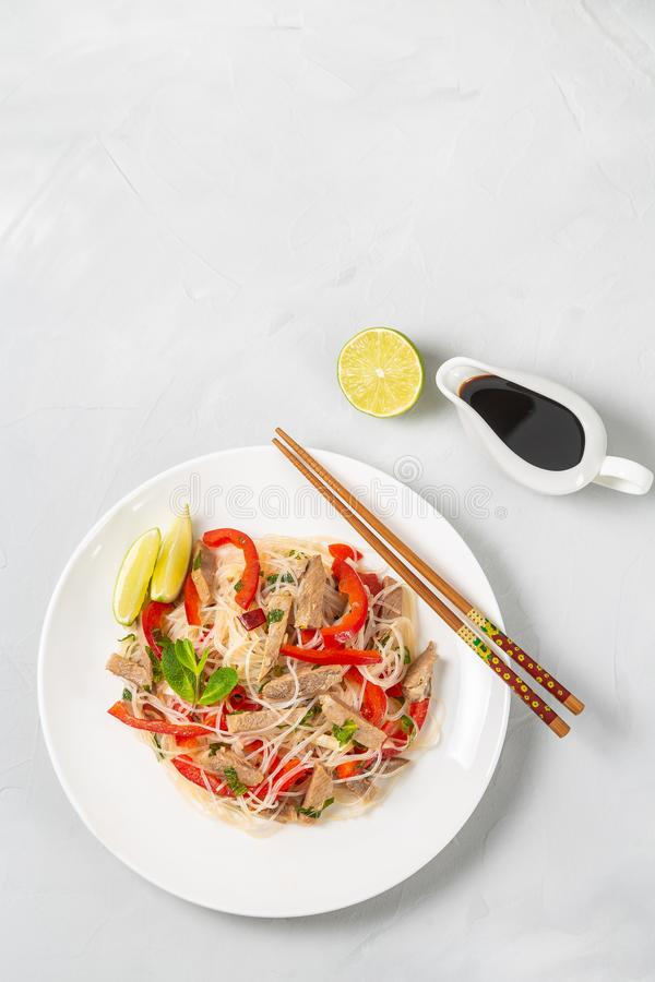 Glass noodles salad with meat. The view from the top. Copy-space. Slat of glass noodles and meat cooked on the street stock image