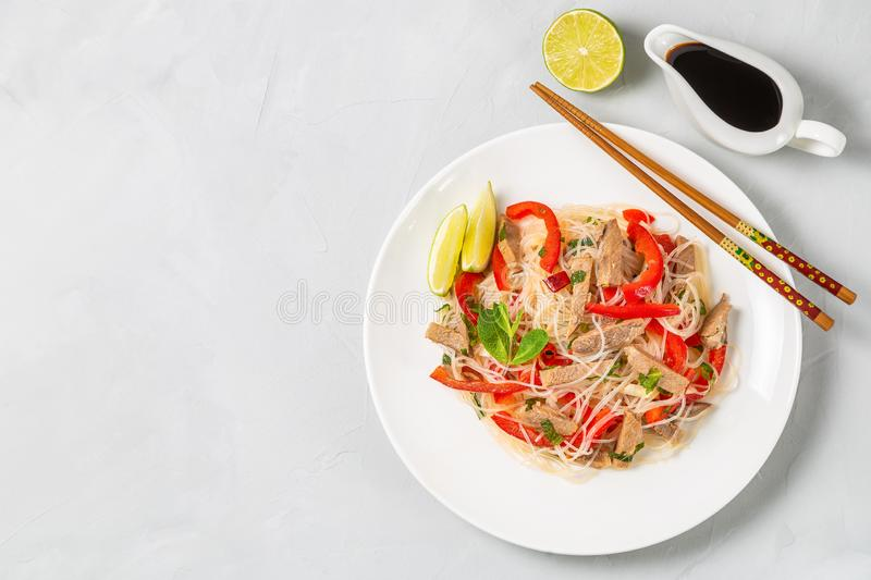 Glass noodles salad with meat. The view from the top. Copy-space. Slat of glass noodles and meat cooked on the street stock photography