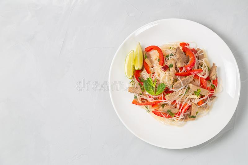 Glass noodles salad with meat. The view from the top. Copy-space. Slat of glass noodles and meat cooked on the street stock photos