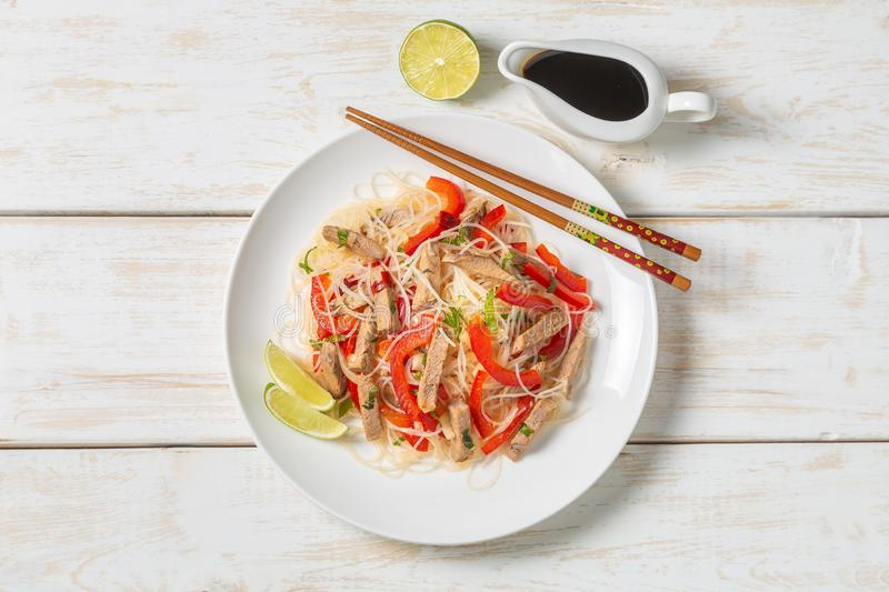 Glass noodles salad with meat. The view from the top. Copy-space. Slat of glass noodles and meat cooked on the street royalty free stock image