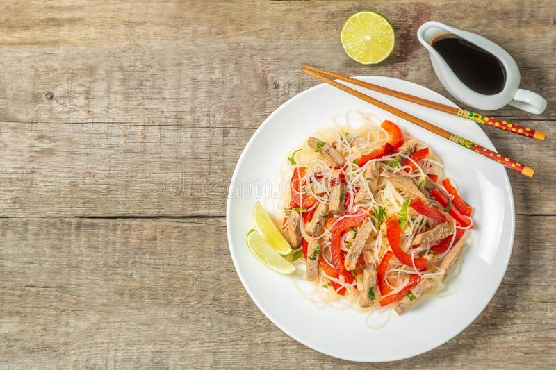Glass noodles salad with meat. The view from the top. Copy-space. Slat of glass noodles and meat cooked on the street royalty free stock photography