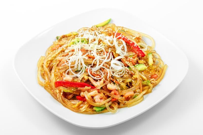 Glass noodles Singapore style, vegetables, shrimp, egg, soy sauce stock photography