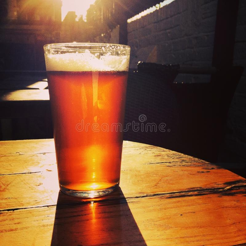 Free Glass Of Beer On Table Outside In Summer Royalty Free Stock Image - 45301116