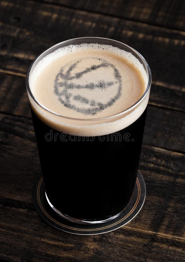 Free Glass Of Stout Beer Top With Basketball Shape Stock Images - 108788164