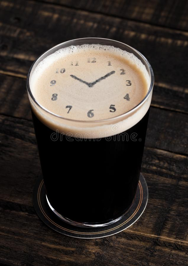 Free Glass Of Stout Beer Top With Clock Shape Royalty Free Stock Photos - 108677818