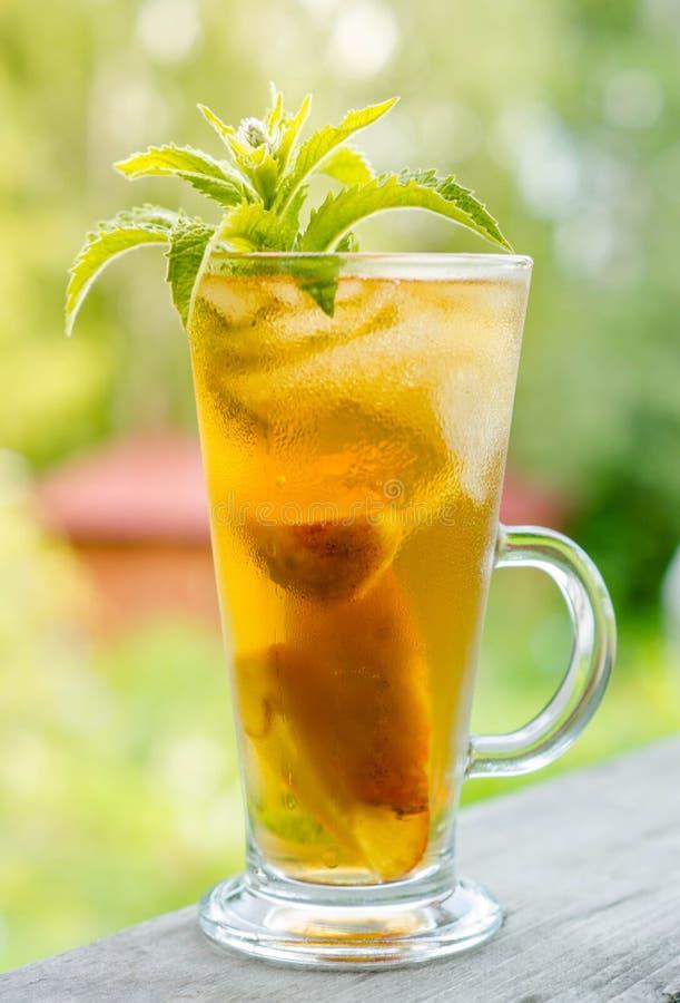 Free Glass Of Sweet Peach Iced Tea Stock Image - 57143211