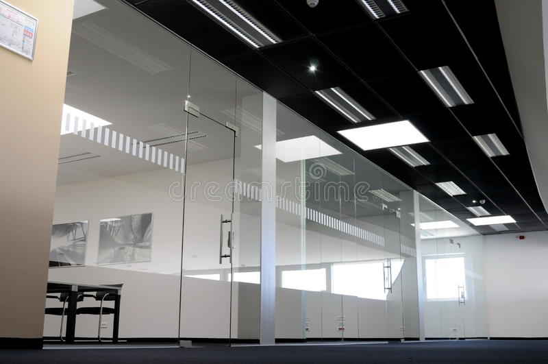 Glass office. Modern office building interior - tempered glass window and doors