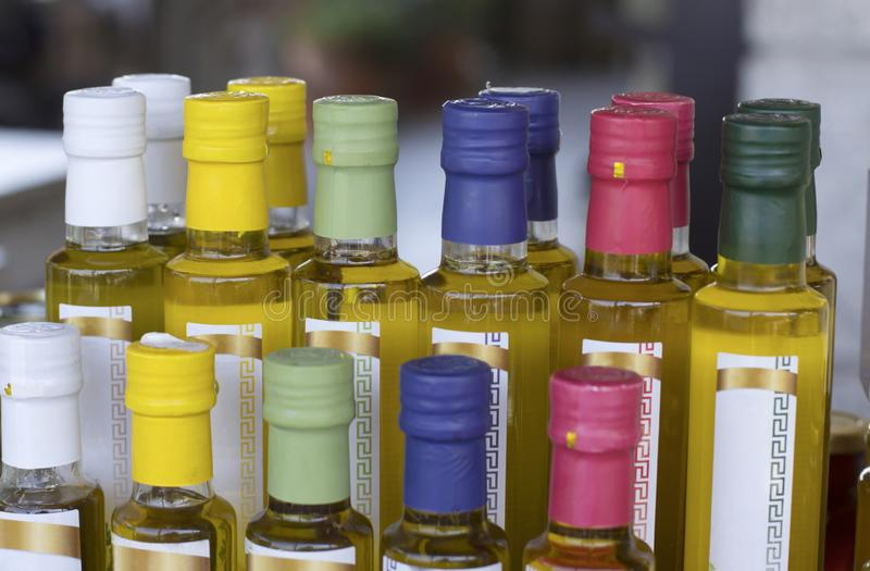 Glass olive oil bottles without trademark with colorful sealed stoppers royalty free stock photos