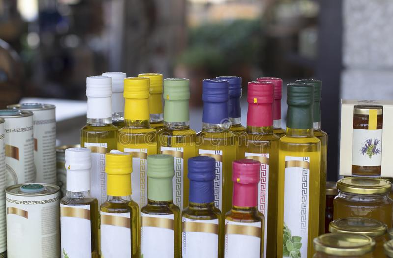 Glass olive oil bottles without trademark with colorful sealed stoppers stock photography