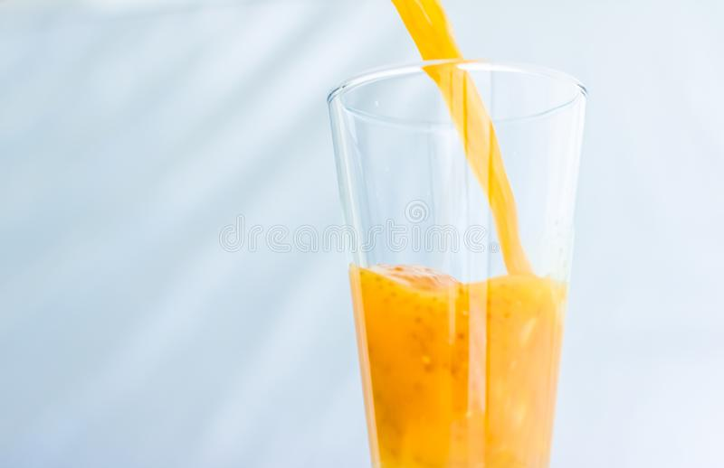 Glass Of Orange Fruit Smoothie Juice With Chia Seeds For