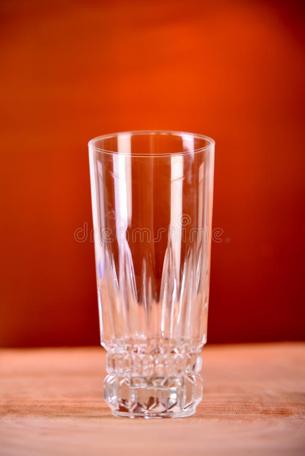 Glass of orange juice on brown background royalty free stock image