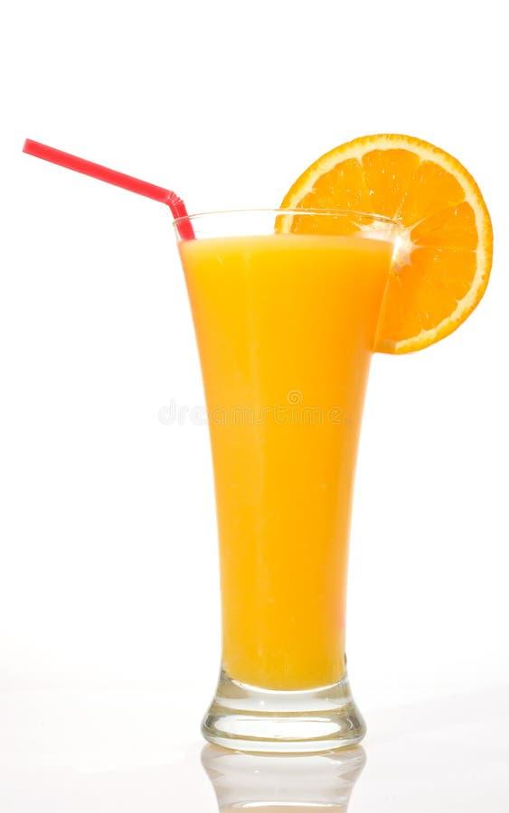 Glass of orange juice with slice stock photos