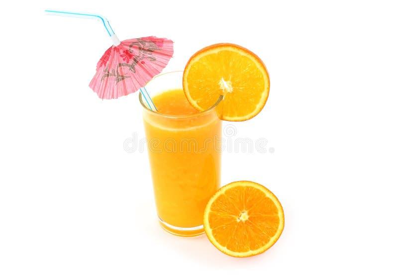 Glass of orange juice with umbrella royalty free stock photo