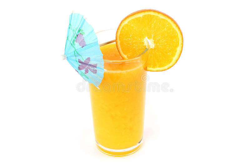Glass of orange juice with umbrella royalty free stock photography
