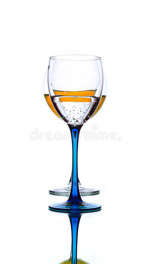 Glass with orange liquid royalty free stock photography