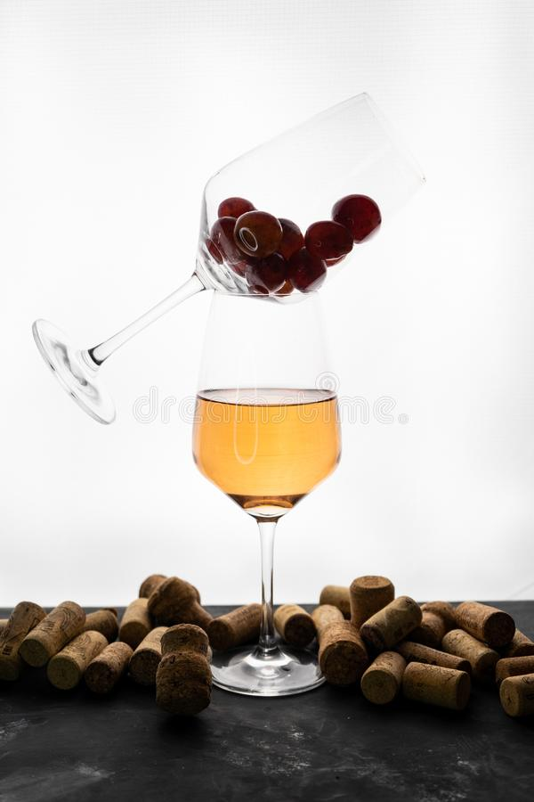 a glass of orange wine with bottle caps royalty free stock image