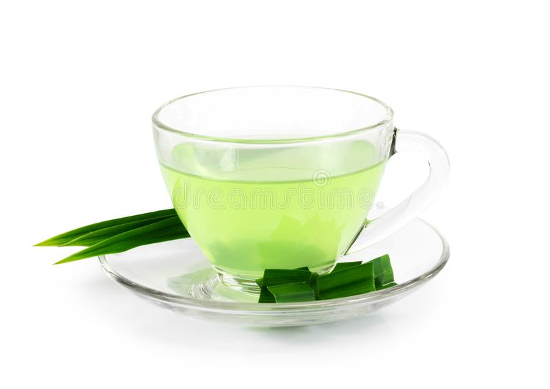 Glass of pandan juice with green leaves isolated on white background stock photo