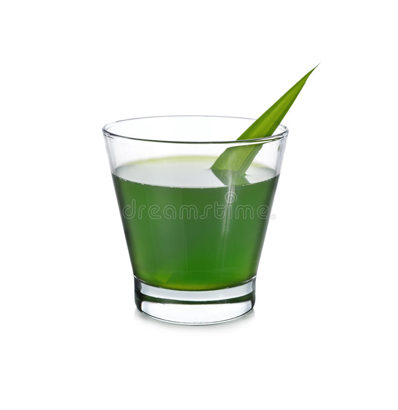 A glass of pandan juice with leaf on white. Background royalty free stock photography