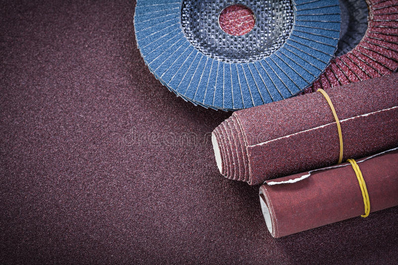 Glass-paper abrasive flap wheels on polishing sheet.  royalty free stock photo