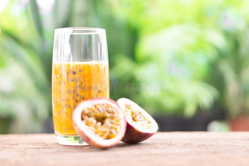 Glass of passion fruit juice wood table with green nature background, food healthy concept, selective focus stock photos