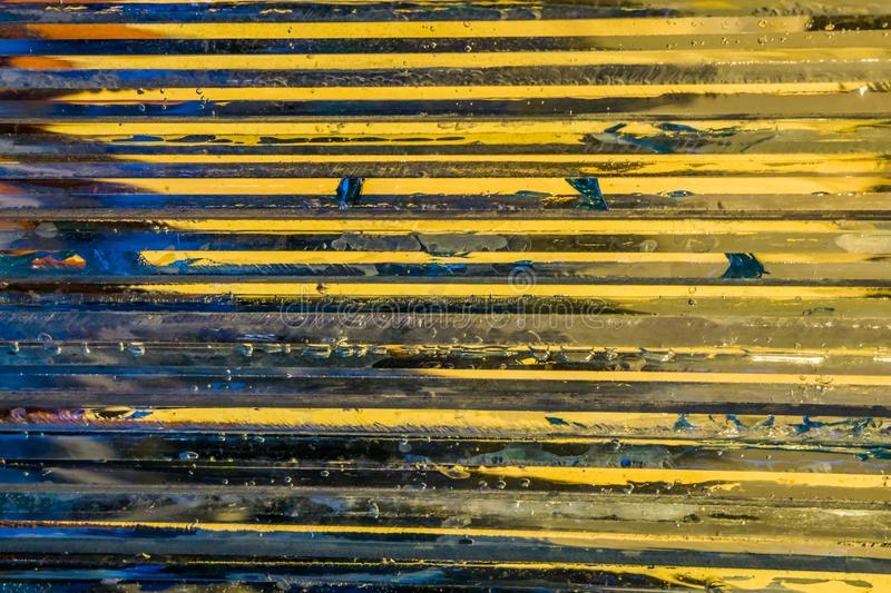 Glass pattern with blue and yellow colors, horizontal lines, modern architecture background royalty free stock image