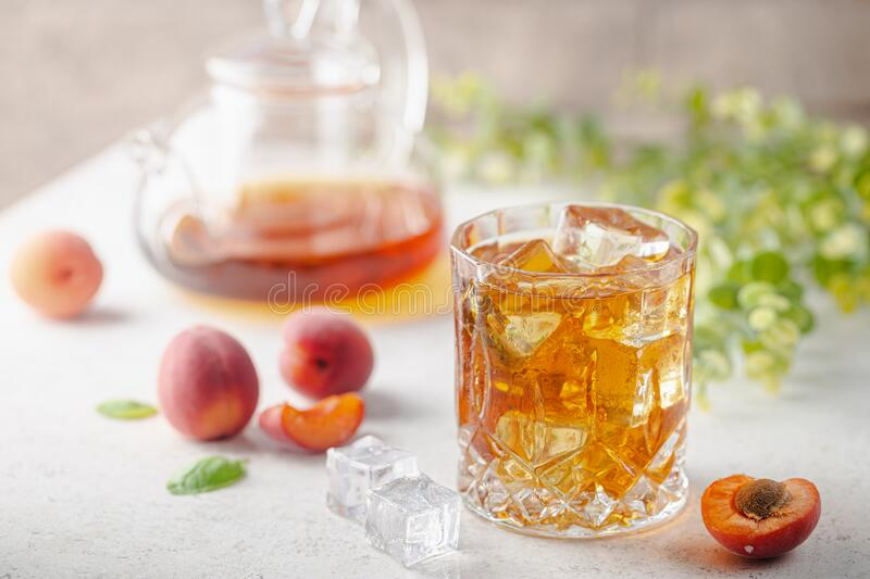 Peach or apricot iced tea stock images