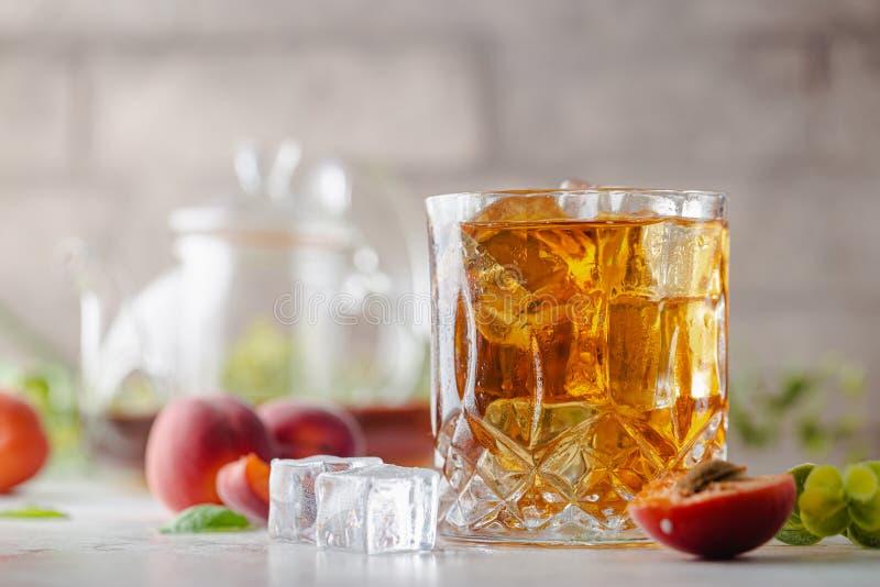 Peach or apricot iced tea stock photos